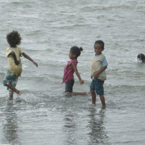 PNG kids having a blast in the ocean.