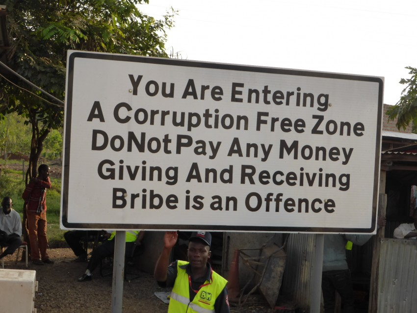 Wow! Welcome to Kenya. One kilometer after this sign, trucker friend Isaac got out money to give to a highway cop.
