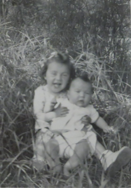 Mom, probably around the age of three here, holding her sister, Sharon.